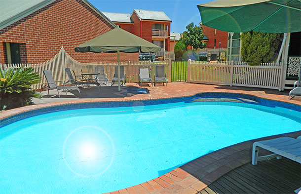 Relax by the pool at The Roseville Apartments